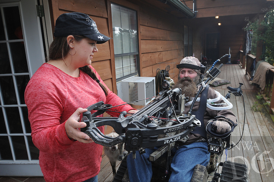 NWA Democrat-Gazette/FLIP PUTTHOFF <br /> Jackie Swope helps her husband, Steve, get ready for a trip to Steve's deer hunting blind Oct. 26 2016.