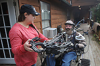 NWA Democrat-Gazette/FLIP PUTTHOFF <br /> Jackie Swope helps her husband, Steve, get ready for a trip to Steve's deer hunting blind Oct. 26 2016.