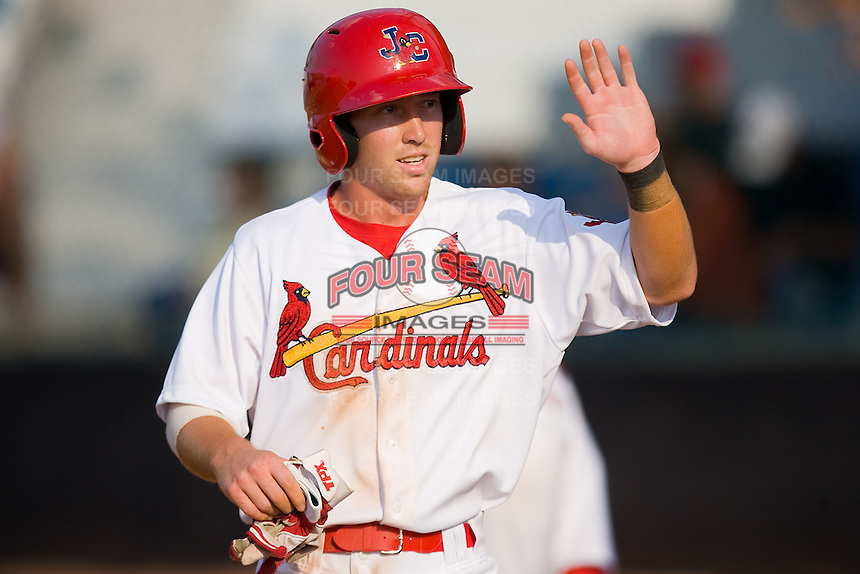 Packy Elkins #9 of the Johnson City Cardinals high fives teammates after scoring a run against the Elizabethton Twins at Howard Johnson Field July 3, 2010, in Johnson City, Tennessee.  Photo by Brian Westerholt / Four Seam Images