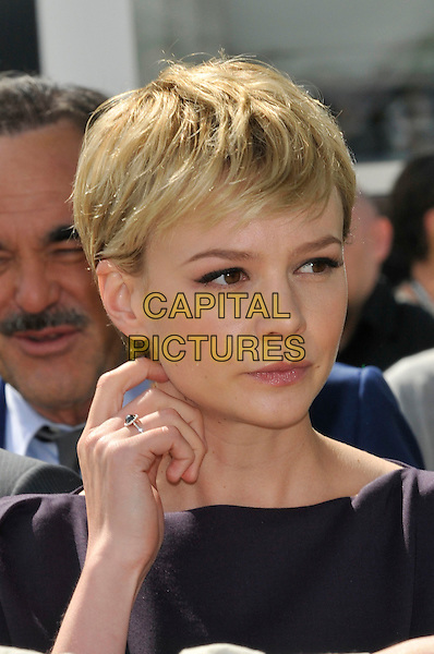 CAREY MULLIGAN.The 'Wall Street: Money Never Sleeps' Photo Call held at the Palais des Festivals during the 63rd Annual International Cannes Film Festival, Cannes, France. .headshot portrait short cropped hair hand ring black navy blue .CAP/PL.©Phil Loftus/Capital Pictures.