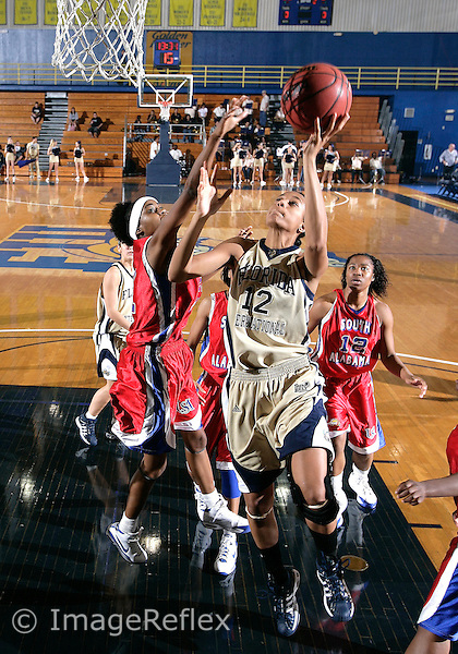 Florida International University women's basketball forward Elisa Carey (12) shoots against the University of South Alabama which won the game 65-47 on December 20, 2008 at Miami, Florida. .