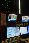 Maria LaRosa, an on-camera meteorologist, is seen on screen inside a studio at The Weather Channel in Atlanta, Georgia May 16, 2013.