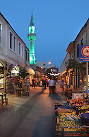 Evening street scene in Canakkale town centre, Turkey. In the distance is the minaret of the Yali Cami mosque. Canakkale is on the southern (Asian) coast of the Dardanelles. Picture by Manuel Cohen