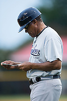 Pulaski Yankees manager Tony Franklin (18) checks his lineup card during the game against the Burlington Royals at Burlington Athletic Park on August 6, 2015 in Burlington, North Carolina.  The Royals defeated the Yankees 1-0. (Brian Westerholt/Four Seam Images)