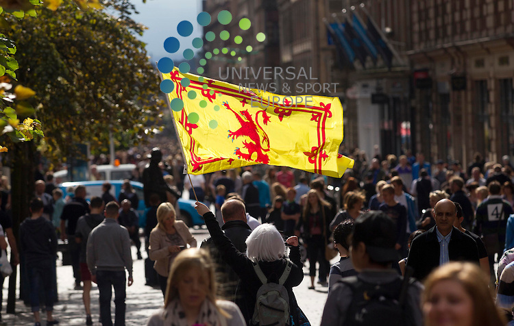 Scotland fans with a flag in Glasgow city Centre before the start of Scotland v Serbia at Hampden as both sides begin their World Cup qualifying..Picture: Universal News And Sport (Europe). 8 September  2012. www.unpixs.com.