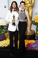 HOLLYWOOD, LOS ANGELES, CA, USA - MARCH 02: Jared Leto, Anne Hathaway at the 86th Annual Academy Awards - Press Room held at Dolby Theatre on March 2, 2014 in Hollywood, Los Angeles, California, United States. (Photo by Xavier Collin/Celebrity Monitor)