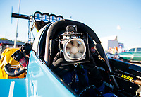 Oct 11, 2019; Concord, NC, USA; NHRA top fuel driver Leah Pritchett uses a fan to stay cool during qualifying for the Carolina Nationals at zMax Dragway. Mandatory Credit: Mark J. Rebilas-USA TODAY Sports