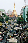 A busy street with traffic on December 27, 1996 in central Rangoon (Yangon), Burma (Myanmar). A military government took power in the country in 1988 after they annulled the election results. Burma has suffered economic and political sanctions ever since, because of the dictatorship and abuse and arrests of opposition leaders. (Photo by: Per-Anders Pettersson)