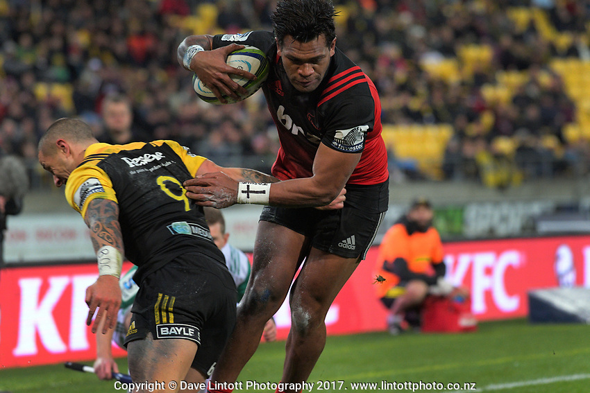 Seta Tamanivalu steps inside TJ Perenara to score during the Super Rugby match between the Hurricanes and Crusaders at Westpac Stadium in Wellington, New Zealand on Saturday, 15 July 2017. Photo: Dave Lintott / lintottphoto.co.nz