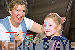 Trish O'Sullivan applying a splash of 'colour' to Emily O'Sullivan at the 'Rock by the Sea' party in Portmagee.