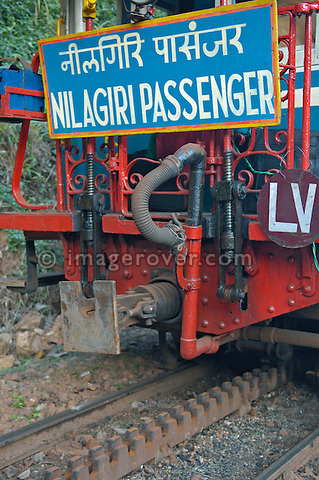 Rack system inbetween rail tracks for the Nilgiri Mountain Railway. An Abt rack and rail system is used by a steam locomotive for the steepest part of the scenic journey through the Blue Mountains between Coonoor and Mettupalayam. India, Tamil Nadu. --- Info: The Nilgiri Mountain Railway (NMR) is the only rack railway in India and connects the town of Mettupalayam with the hill station of Udagamandalam (Ooty), in the Nilgiri Hills of southern India. The construction of the 46km long meter-gauge singletrack railway in Tamil Nadu State was first proposed in 1854, but due to the difficulty of the mountainous location, the work only started in 1891 and was completed in 1908. This railway, scaling an elevation of 326m to 2,203m and still in use today, represented the latest technology of the time. In July 2005, UNESCO added the NMR as an extension to the World Heritage Site of Darjeeling Himalayan Railway.