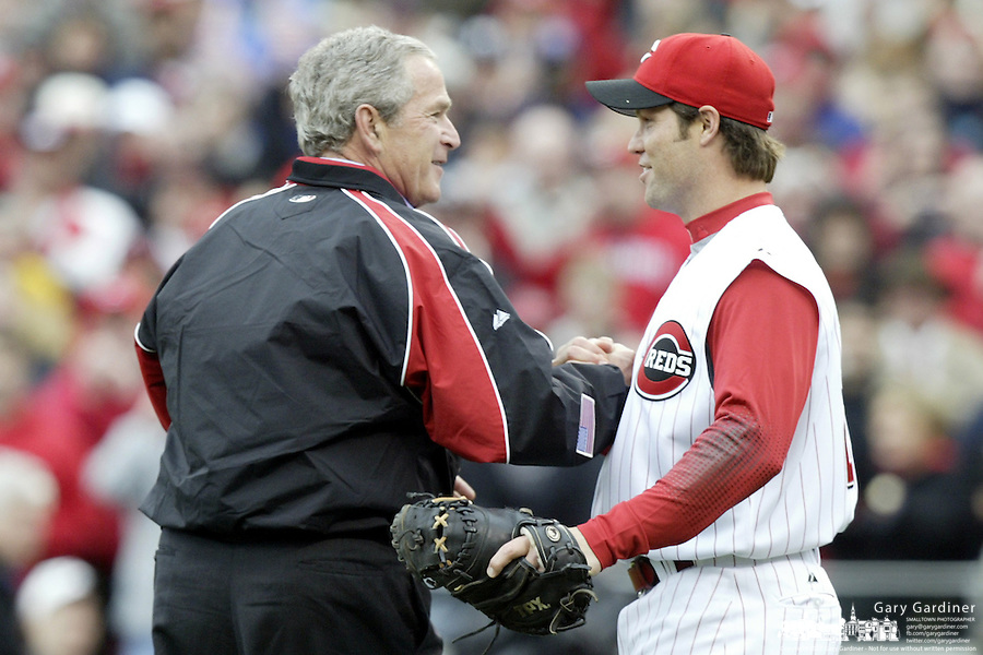 03 April 2006: President Bush shakes hands with Cincinnati Red catcher Jason LaRue after throwing the ceremonial first pitch before the start of the Cincinnati Reds' home opener against the Chicago Cubs at Great American Ballpark in Cincinnati, Ohio.<br />