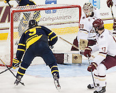 Jace Hennig (Merrimack - 9) scores. - The Boston College Eagles defeated the visiting Merrimack College Warriors 2-1 on Wednesday, January 21, 2015, at Kelley Rink in Conte Forum in Chestnut Hill, Massachusetts.