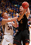 SIOUX FALLS, SD - MARCH 9:  Tony Fiegen #34 of South Dakota State fouls Mitchell Patton #42 of IUPUI during their quarter-final game at the 2013 Summit League Basketball Championships at the Sioux Falls Arena Saturday. (Photo by Dick Carlson/Inertia)