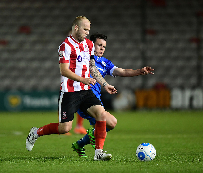 Lincoln City's Bradley Wood is fouled by North Ferriby United's Ryan Fallowfield<br /> <br /> Photographer Chris Vaughan/CameraSport<br /> <br /> Football - Vanarama National League - Lincoln City v North Ferriby United - Tuesday 9th August 2016 - Sincil Bank - Lincoln<br /> <br /> &copy; CameraSport - 43 Linden Ave. Countesthorpe. Leicester. England. LE8 5PG - Tel: +44 (0) 116 277 4147 - admin@camerasport.com - www.camerasport.com