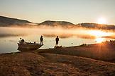 USA, Oregon, Paulina Lake, Brown Cannon, two young boys on the shoreline of Paulina Lake at dawn