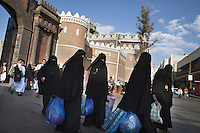 Women walk along a street in Sana'a.