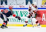 S&ouml;dert&auml;lje 2014-10-23 Ishockey Hockeyallsvenskan S&ouml;dert&auml;lje SK - Malm&ouml; Redhawks :  <br /> Malm&ouml; Redhawks Jens Olsson i kamp om pucken med S&ouml;dert&auml;ljes Adam Hansen <br /> (Foto: Kenta J&ouml;nsson) Nyckelord: Axa Sports Center Hockey Ishockey S&ouml;dert&auml;lje SK SSK Malm&ouml; Redhawks