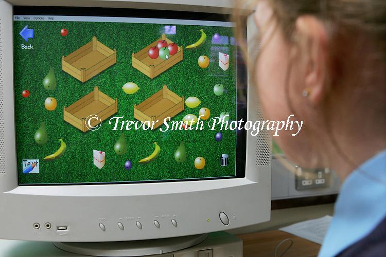 Child using interactive program on school computer
