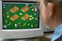 Child using interactive program on school computer