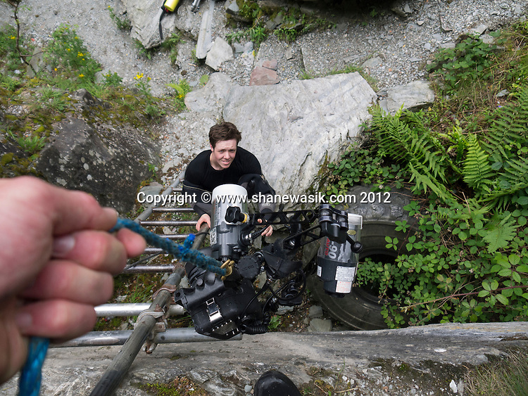 Lowering the camera down into the quarry