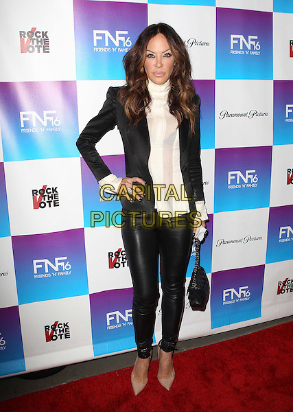 Robin Antin.Paramount Studios' 16th Annual Friends 'N' Family Party Held At Paramount Studios, Los Angeles, California,.USA, 8th February 2013..full length black leather pants trousers hand on hip white shirt jacket blazer chanel bag beige nude shoes high polo neck .CAP/ADM/KB.©Kevan Brooks/AdMedia/Capital Pictures.