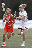 Syracuse University defender Linley Block (16) on the attack as Boston College midfielder Mikaela Rix (17) defends.  Syracuse University (orange) defeated Boston College (white), 17-12, on the Newton Campus Lacrosse Field at Boston College, on March 27, 2013.