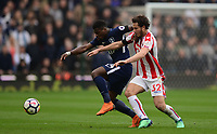 Serge Aurier of Tottenham battles for the ball with Ramadan of Stoke during the EPL - Premier League match between Chelsea and West Ham United at Stamford Bridge, London, England on 8 April 2018. Photo by PRiME Media Images.