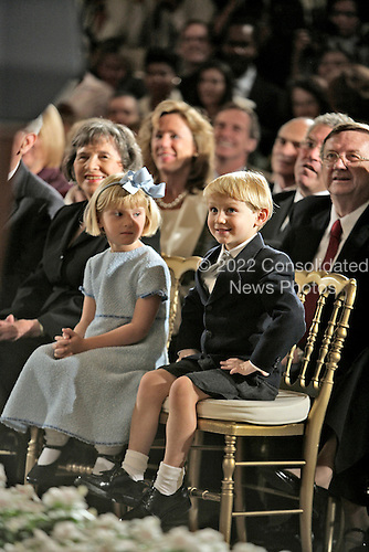 Washington, D.C. - September 29, 2005 -- Josie Roberts (in blue dress) and Jack Roberts (in shorts) attend the swearing in ceremony of their father, Judge John G. Roberts, Jr. as Chief Justice of the United States in the East Room of the White house on September 29, 2005..Credit: Eric Draper - White House via CNP