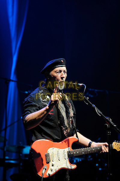Richard Thompson.performing in concert, Shepherd's Bush Empire, London, England. .25th February 2013.on stage lie gig performance music half length hat flat cap scarf black shirt hand finger arm  singing guitar goatee facial hair .CAP/MAR.© Martin Harris/Capital Pictures.