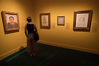 Visitor watches paintings at the Frida Kahlo exhibition at the National Gallery in Budapest, Hungary on July 5, 2018. ATTILA VOLGYI