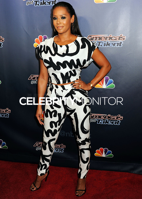 NEW YORK CITY, NY, USA - AUGUST 27: Mel B (Melanie Brown) arrives at the 'America's Got Talent' Post-Show Red Carpet held at Radio City Music Hall on August 27, 2014 in New York City, New York, United States. (Photo by Celebrity Monitor)