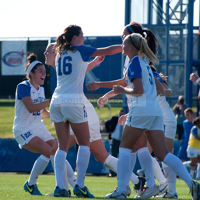 The team gathers to celebrate a strong goal during the University of Kentucky's women's soccer game at the UK Soccer Complex in  Lexington, Ky., on Sunday, October. 21, 2012..