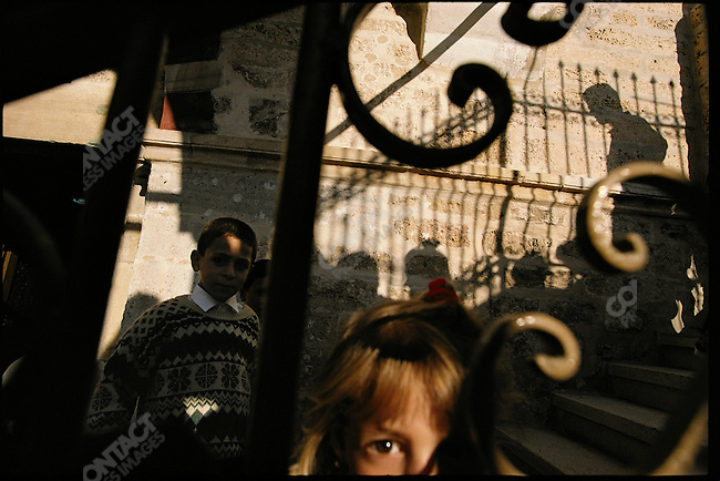 Palestinian children play near and old Eastern Orthodox church, Gaza City, Gaza, April 1995