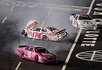 Oct. 15, 2009; Concord, NC, USA; NASCAR Nationwide Series driver Reed Sorenson (10) and Ricky Stenhouse Jr (17) crash during the Dollar General 300 at Lowes Motor Speedway. Mandatory Credit: Mark J. Rebilas-