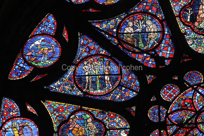 Detail of the Rose window of the North transept, c. 1240, with Adam and Eve in the Garden of Eden, with the apple tree and serpent, in the Cathedrale Notre-Dame de Reims or Reims Cathedral, Reims, Champagne-Ardenne, France. The cathedral was built 1211-75 in French Gothic style with work continuing into the 14th century, and was listed as a UNESCO World Heritage Site in 1991. Picture by Manuel Cohen