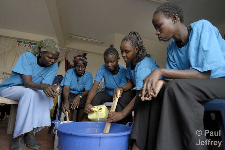 Members of Operation Hope, a support group of HIV+ widows in Nairobi who have received organizational and microcredit support from United Methodist Women, make detergent during one of their meetings. The women make the detergent in bulk, package it and sell it in Nairobi.