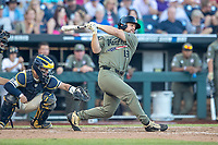 Vanderbilt Commodores outfielder Stephen Scott (19) follows through on his swing against the Michigan Wolverines during Game 1 of the NCAA College World Series Finals on June 24, 2019 at TD Ameritrade Park in Omaha, Nebraska. Michigan defeated Vanderbilt 7-4. (Andrew Woolley/Four Seam Images)