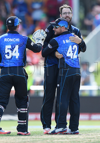 08.03.2015. Napier, New Zealand.  Daniel Vettori celebrates the wicket of Nawroz Mangal with team mates during the ICC Cricket World Cup match between New Zealand and Afghanistan at McLean Park in Napier, New Zealand. Sunday 8 March 2015.