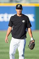 Tyler Saladino (8) of the Charlotte Knights warms up in the outfield prior to the game against the Gwinnett Braves at BB&T Ballpark on April 16, 2014 in Charlotte, North Carolina.  The Braves defeated the Knights 7-2.  (Brian Westerholt/Four Seam Images)