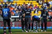 NZ bowler Trent Boult considers a review during the ICC Cricket World Cup one day pool match between the New Zealand Black Caps and England at Wellington Regional Stadium, Wellington, New Zealand on Friday, 20 February 2015. Photo: Dave Lintott / lintottphoto.co.nz