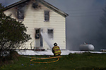 Volunteer firefighters fighting a house fire
