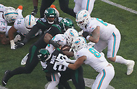 running back Patrick Laird (42) of the Miami Dolphins wird gestoppt - 08.12.2019: New York Jets vs. Miami Dolphins, MetLife Stadium New York