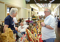 NWA Democrat-Gazette/BEN GOFF @NWABENGOFF<br /> Kathy Morey chats with Dennis Owens, both of Rogers, on Sunday Sept. 13, 2015 at Morey's table during the Woodcarvers of Northwest Arkansas show at Frisco Station Mall in Rogers.