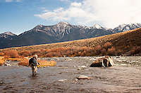 An angler fishes on the Madison River near Three Dollar Bridge in southwest Montana.