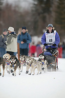 Dog Musher Melanie Gould leaves the shoot for the 1000 mile 2003 Iditarod sled dog race from Fairbanks to Nome, Alaska . Lack of snow along the normal trail route further south forced the relocation of the restart on the Chena River in Fairbanks.