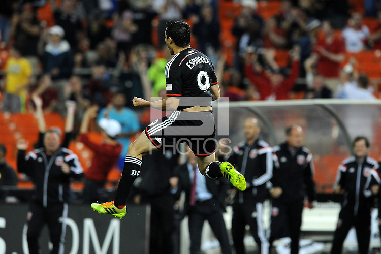 Washington D.C. - May 17, 2014: Fabian Espindola (9) of D.C. United celebrates his score in the 63th minute of the game.  D.C. United defeated  the Houston Dynamo 2-0 during a Major League Soccer match for the 2014 season at RFK Stadium.