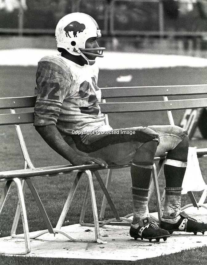 Buffalo Bill's running back O.J. Simpson sits alone on the bench after being beat up by the Oakland Raider defense. (1972 photo by Ron Riesterer)