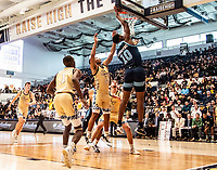 WASHINGTON, DC - FEBRUARY 8: Cyril Langevine #10 of Rhode Island shoots over Jameer Nelson Jr. #12 of George Washington during a game between Rhode Island and George Washington at Charles E Smith Center on February 8, 2020 in Washington, DC.