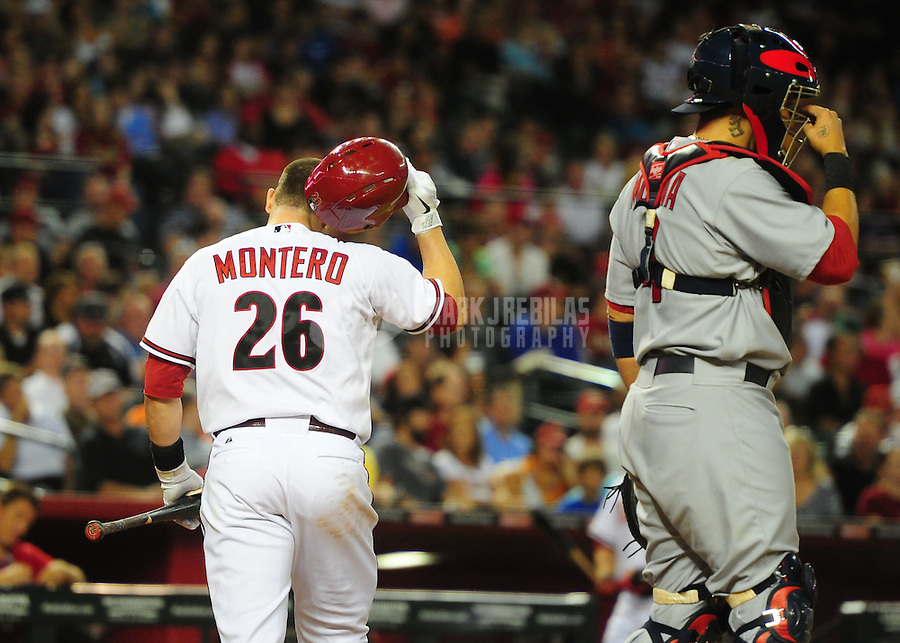 May 8, 2012; Phoenix, AZ, USA; Arizona Diamondbacks catcher (26) Miguel Montero reacts after striking out in the sixth inning against the St. Louis Cardinals at Chase Field. Mandatory Credit: Mark J. Rebilas-